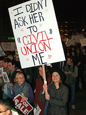 English: A woman makes her support of her marr...
