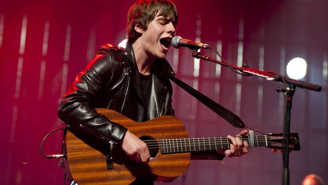 Jake Bugg performs on stage at the Roundhouse, London, during the iTunes Festival 2013