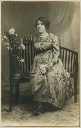 Woman seated and flowers