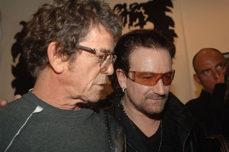 Singer Bono (R) and Lou Reed talk at the Edun Fall 2006 Presentation during Olympus Fashion Week February 5, 2006 in New York City