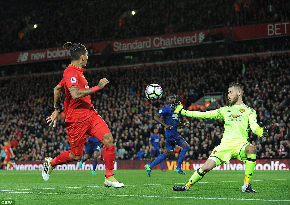 De Gea sticks out a hand at Firmino's effort as he kept a clean sheet to earn United a Premier League point at Anfield