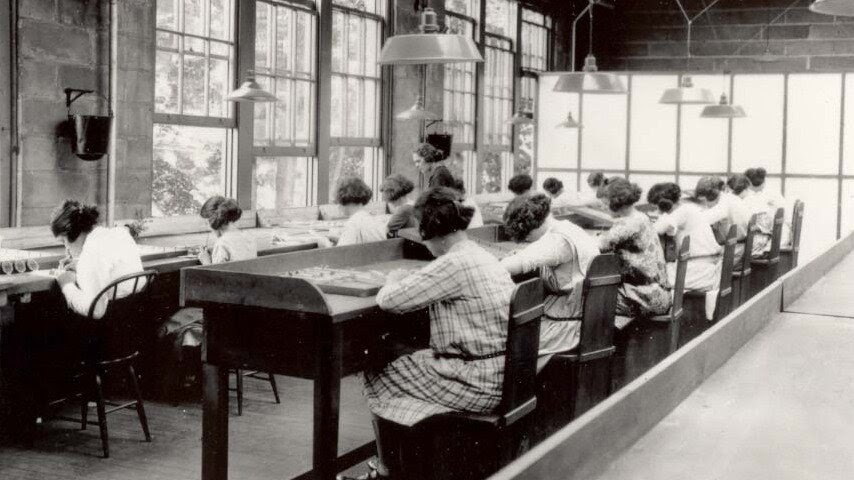"Employees of the U.S. Radium Corp. paint numbers on the faces of wristwatches using dangerous radioactive paint. Dozens of women, known as ""radium girls,"" later died of radium poisoning. The last radium girl died this year at 107."