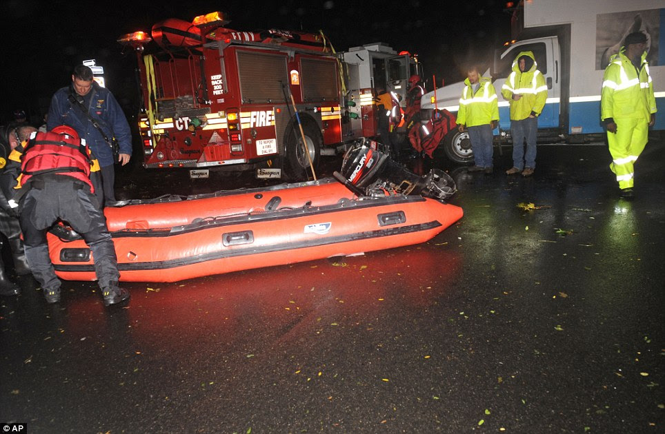 Fire rescue: An FDNY inflatable is prepared for launch along 14th street east of Avenue B where water has trapped people in the wake of Hurricane Sandy