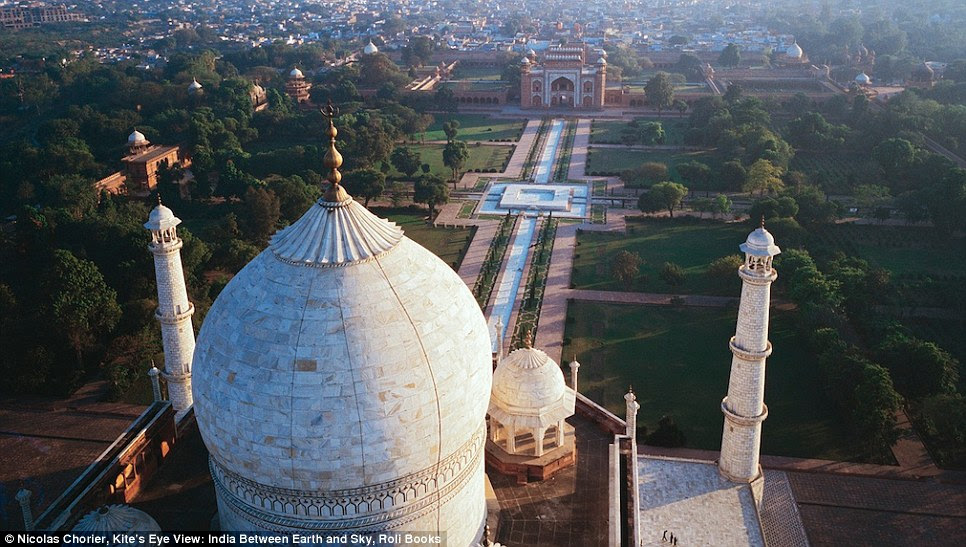 The iconic white stonework of the Taj Mahal with the city of Agra behind - 47-year-old Nicolas developed his passion for photography after growing up in France with weekly slide shows around the fireplace