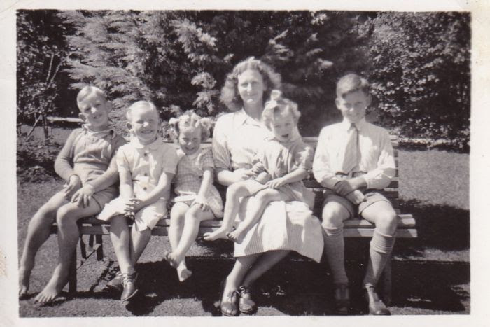 Peter Harrison (right) with his mother and sisters and brother