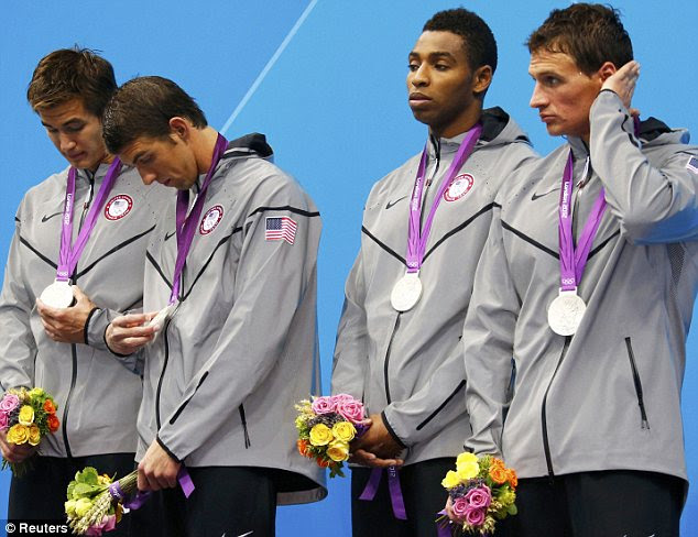 Silver dud: Nathan Adrian, Michael Phelps, Cullen Jones and Ryan Lochte look befuddled by their silver medals after the 4x100m freestyle relay