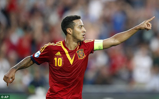 Hat-trick hero: Thiago Alcantara netted three goals in the first half to set Spain on their way