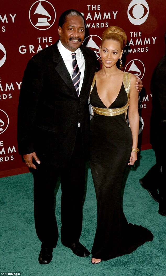 Beyonce's father Mathew Knowles says she wouldn't be as famous if she had darker skin; the two are seen together at the Grammys in 2005