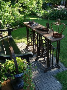Old sewing machine tables as garden furniture.