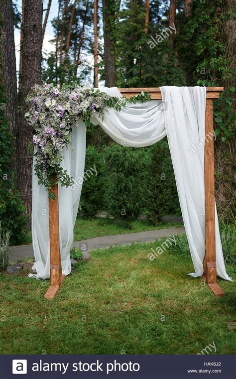 Beautiful wedding arch decorated with flowers in the Park