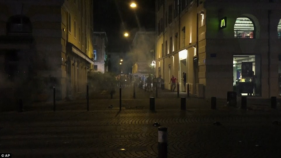Deterrent: Police use tear gas to disperse the angry crowds after trouble flared with England fans in Marseille
