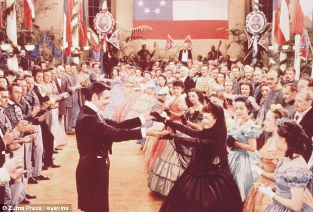 Change of plan: St Edmund's College, Cambridge, has dropped plans for a Gone With The Wind themed summer ball after complaints it was racist