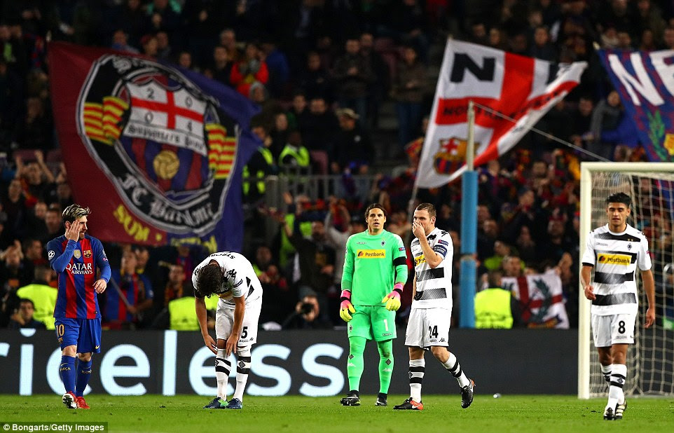 Swiss goalkeeper Yann Sommer of Borussia Monchengladbach (centre left) shows his dejection after conceding