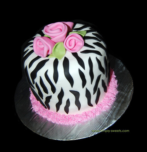 Zebra print cake with pink roses