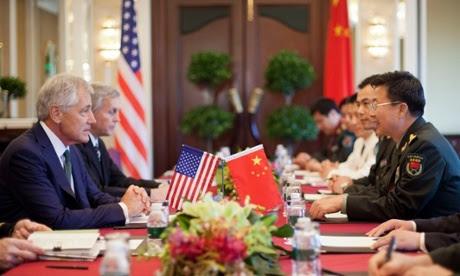 US Defense Secretary Chuck Hagel, left, listens to Lt. Gen. Wang Guanzhong, of China