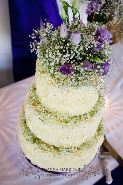 top tier wedding cake decorated with gypsophila and purple