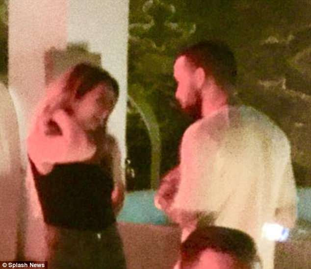 Chit chat: Liam Payne was pictured chatting to his backing dancer Chloe Ferns as he enjoyed a night out in Dubai at the exclusive Penthouse Bar in the luxury Five Palm Jumeirah hotel