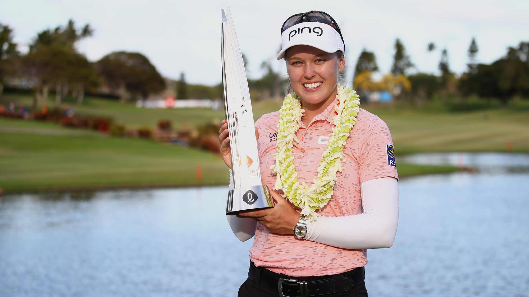 Brooke Henderson holds her second LOTTE trophy