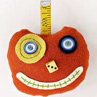 Orange pumpkin pincushion