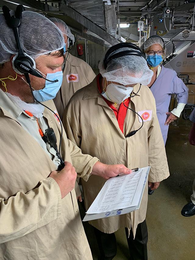President Domingo Garcia inspecting Tyson plant