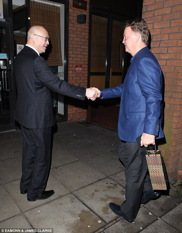 Van Gaal, sporting a sharp blue blazer, is greeted as he arrives at the Wing's restaurant, one of his favourites