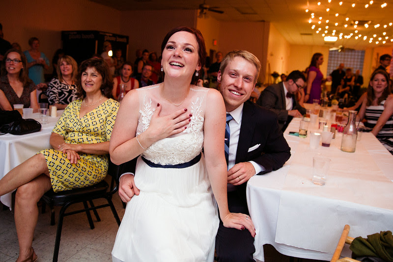 Bridesmaid sings a toast at a wedding Reception at the Verdi Club in Rockford IL by Mindy Joy Photography