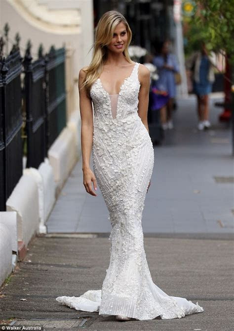Natalie Roser stuns in a lace princess style wedding gown