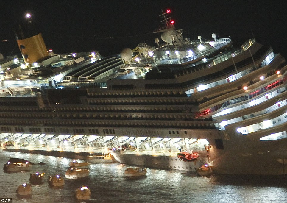 Escape: A boat is seen near the front of the ship being lowered into the water, containing holidaymakers who minutes earlier had been enjoying dinner