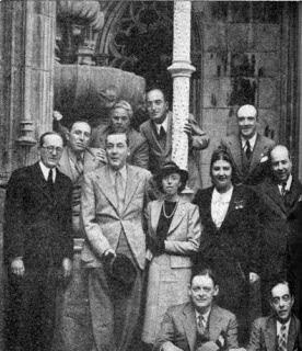Sintra (Portugal) 1948: Seated are T. S. Eliot and our Editor. — Middle row (from the left): Robert de Traz, Jacques de Lacretelle, Mme de Lacretelle, Mme. A Ferro, António Ferro — Upper row (from the left): Máximo Buontempelli, Aldo Bizarri, Eng. J. Silva Dias.