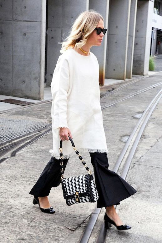 Le Fashion Blog Street Style Jessie Bush Three Trends Long Layers White Dress With Fringed Hem Black Cropped Pants With A Statement Flare Woven Bag Short Block Heels Via Harpers Bazaar Australia