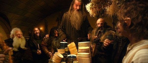 Gandalf and several dwarves dine at Bilbo Baggins' homestead in the Shire in THE HOBBIT: AN UNEXPECTED JOURNEY.
