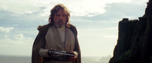 Luke Skywalker (Mark Hamill) holds the lightsaber hilt that once belonged to his father in STAR WARS: THE LAST JEDI.
