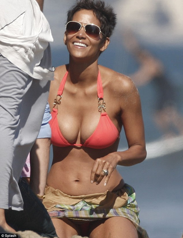 Time for a breather: Heavy-breathing Halle looks relieved to be able to have a rest and relax on the sand