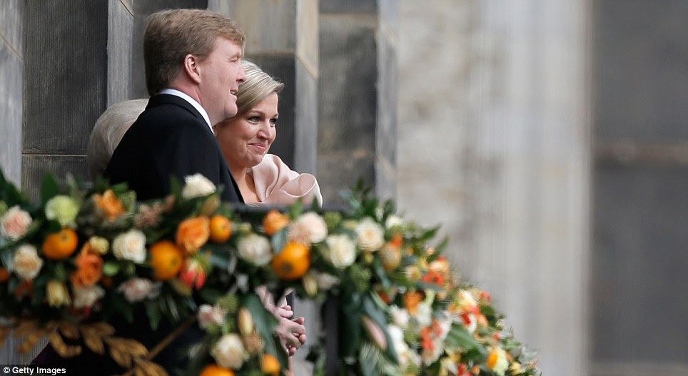 Royal couple: The balcony was turned into a bower of flowers to mark the state occasion with many blooms in the national orange