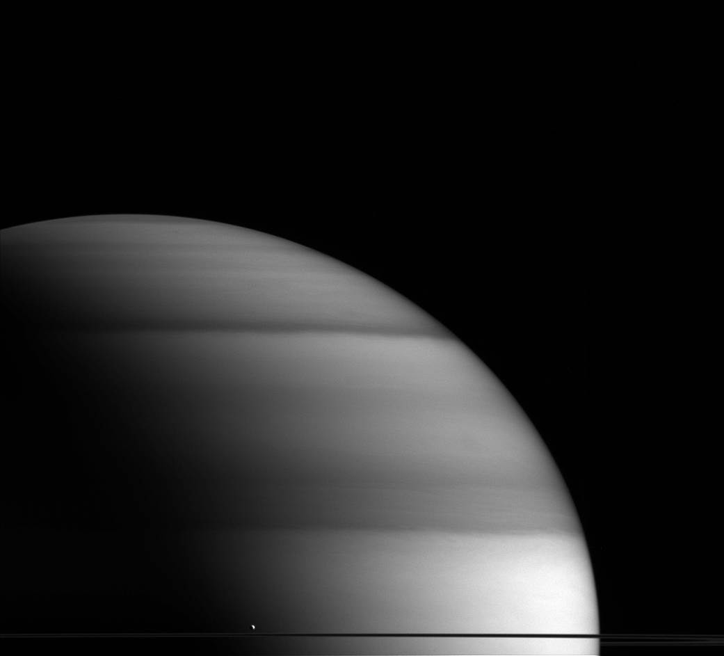 The water-world Enceladus appears here to sit atop Saturn's rings
