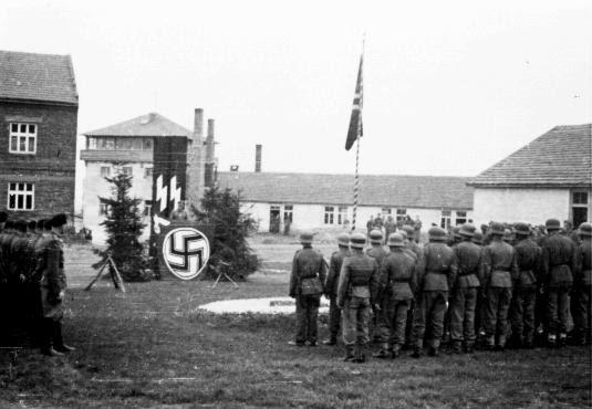 Camp commandant Amon Goeth addresses SS guards. Plaszow, Poland, 1943-1944.