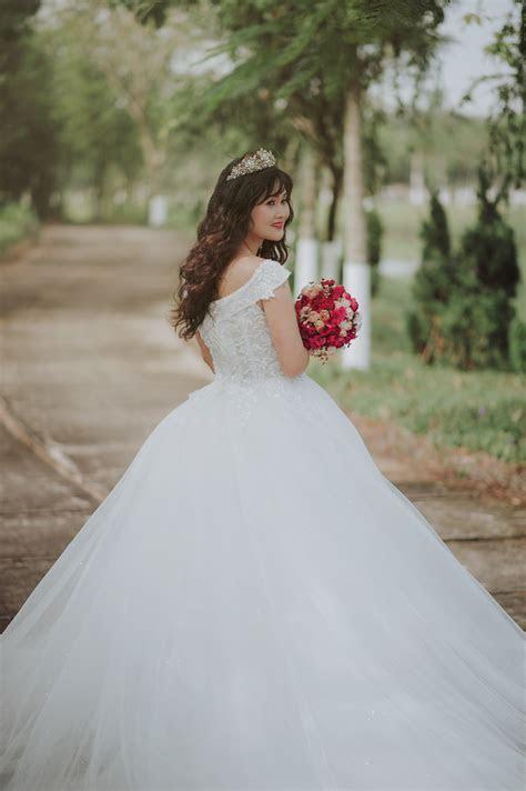 Tie a Corset Back Wedding Dress · Free Stock Photo