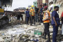 The Latest: Nigeria calls off search at collapsed school