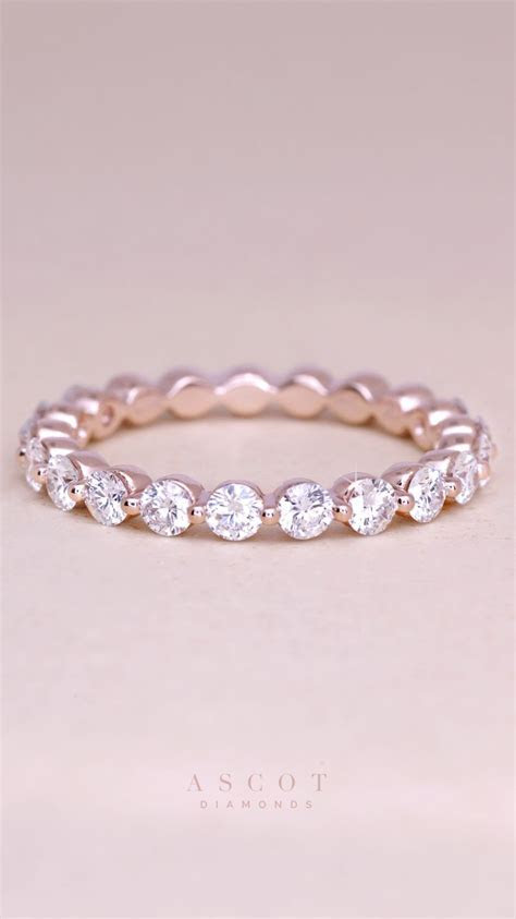 A custom rose gold thin diamond eternity wedding band