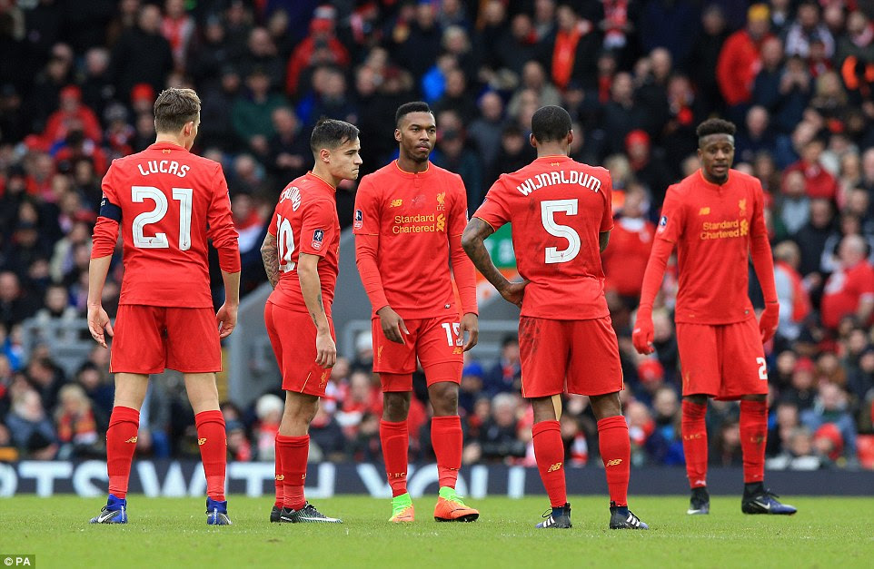 The Liverpool players show their frustration on the pitch as they face up to a shock fourth round FA Cup exit to Wolves