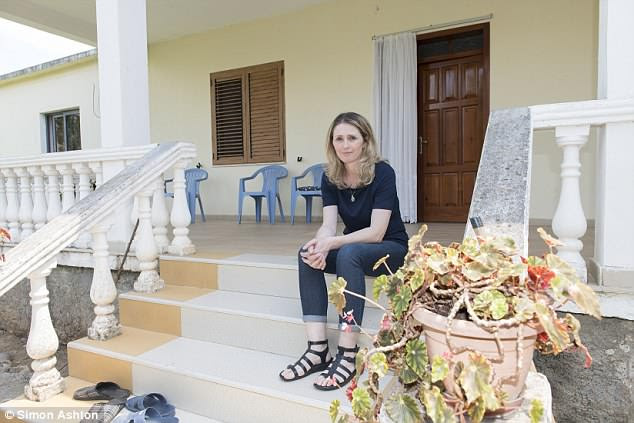 Cile is staying that the home where she grew up in Albania before fleeing the country in 2000