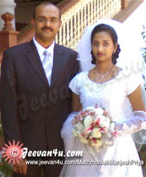Manjesh Priya Marriage Photos at St Thomas Cathedral Palai
