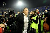 Belgium's football coach Marc Wilmots celebrates his team's victory over Croatia during their World Cup 2014 qualifying match in Zagreb on October 11, 2013