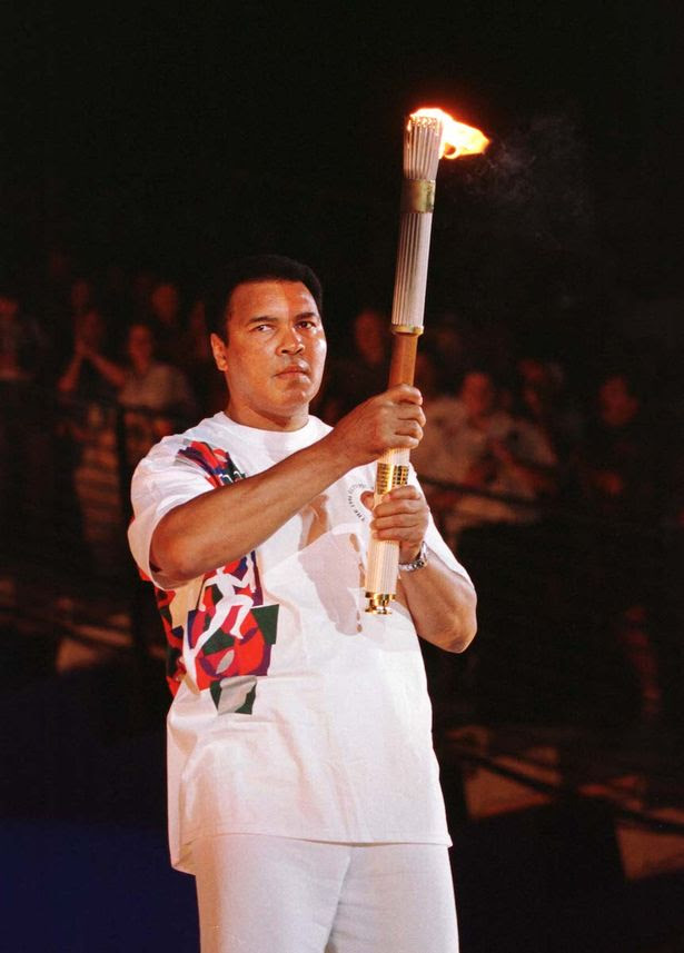 Muhammad Ali lighting Olympic Torch in 1996