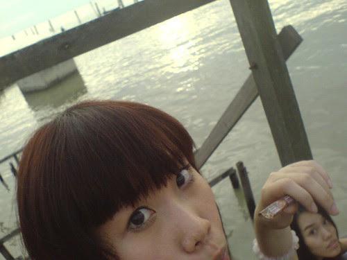 Miharu gropes Mei Fen's head