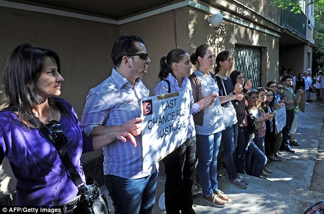 Prior to his arrest: The European Union of Jewish Students stand with their hands taped together in front of Csatary's home
