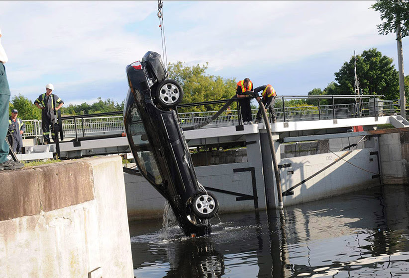 A car (pictured) found at the bottom of an eastern Ontario canal with the bodies of three sisters and their father's first wife suspended in the water inside seemed to trace a very deliberate path, a murder trial heard Friday Oct. 21, 2011. (CP)
