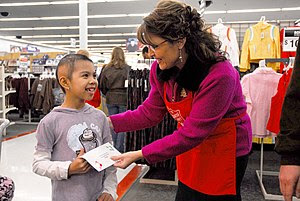 Gov. Sarah Palin presents a gift-card donated ...