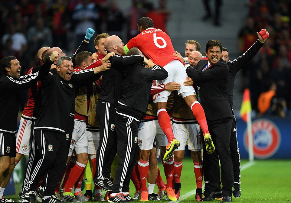 Williams jumps into his team-mates' arms after scoring the goal that Wales' response to going behind had thoroughly merited