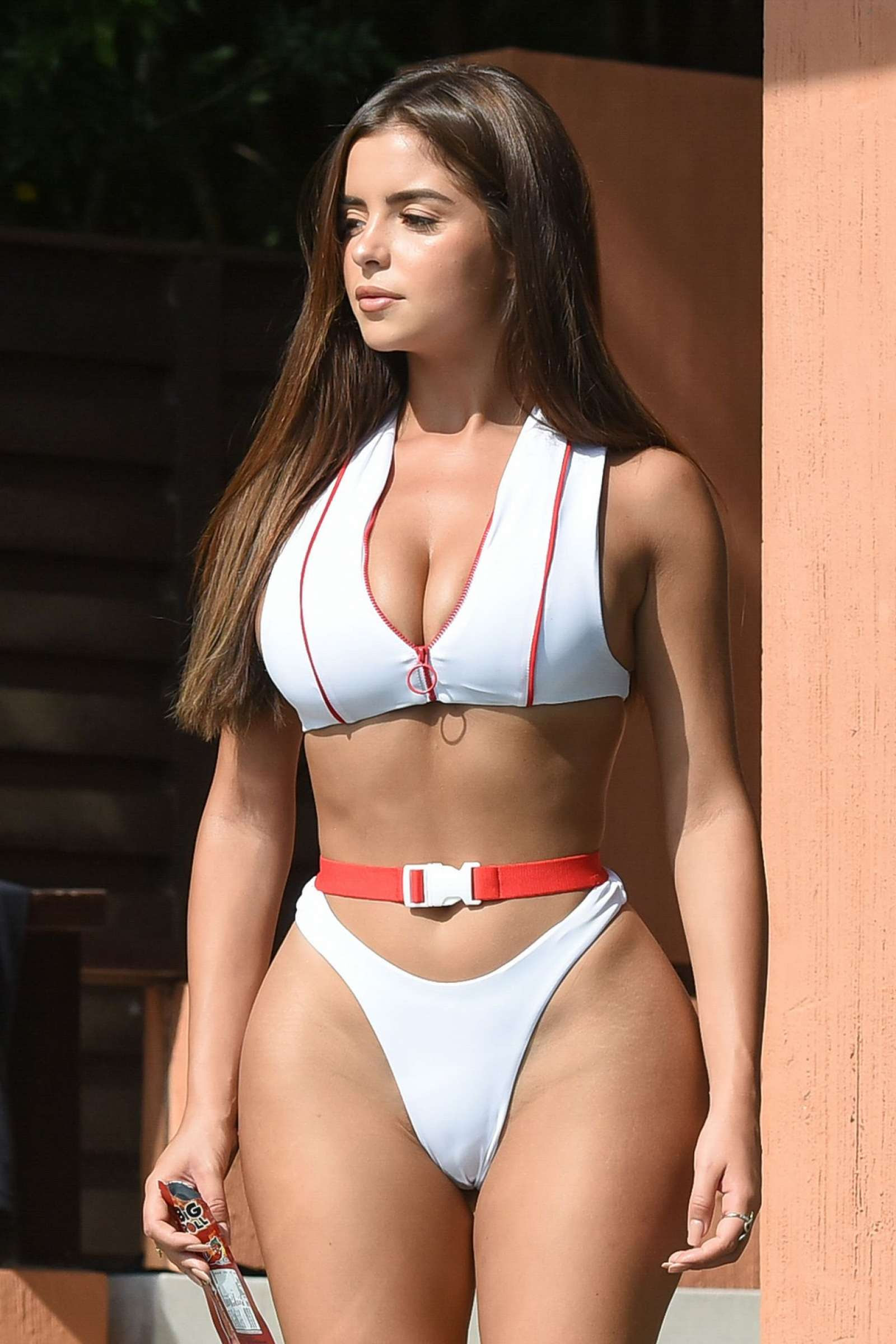 Demi Rose in White Bikini on the pool in Phuket